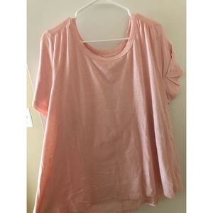Pale pink knit top with peekaboo back